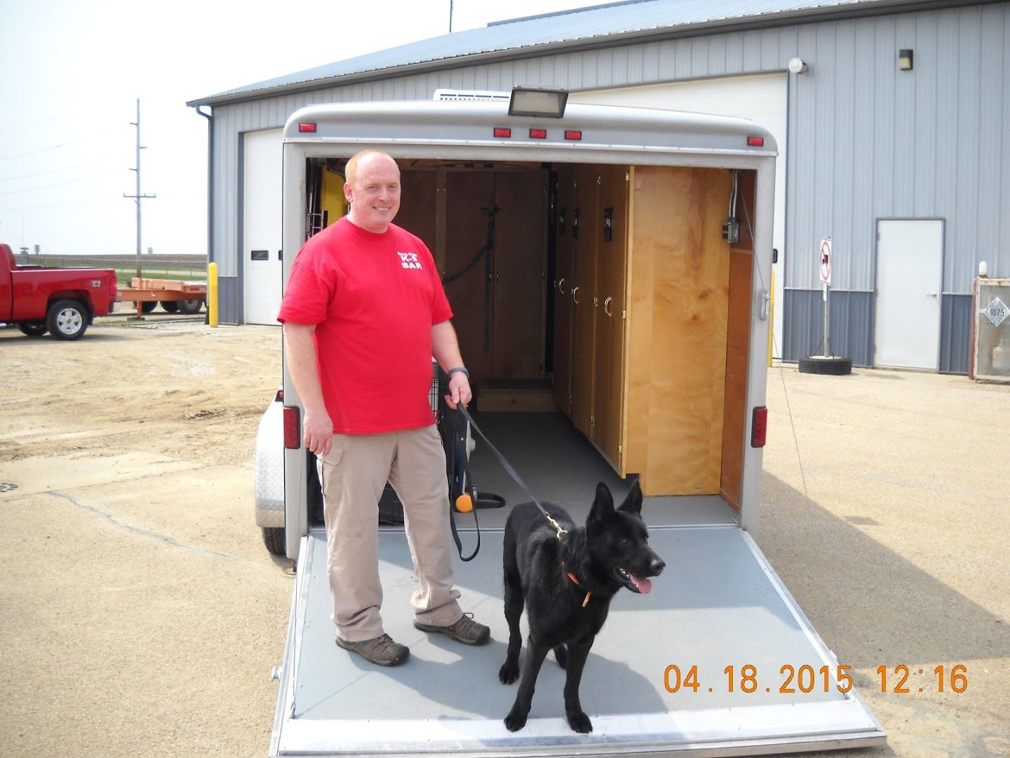 Emergency Management Representative of Search and Rescue with black dog on leash