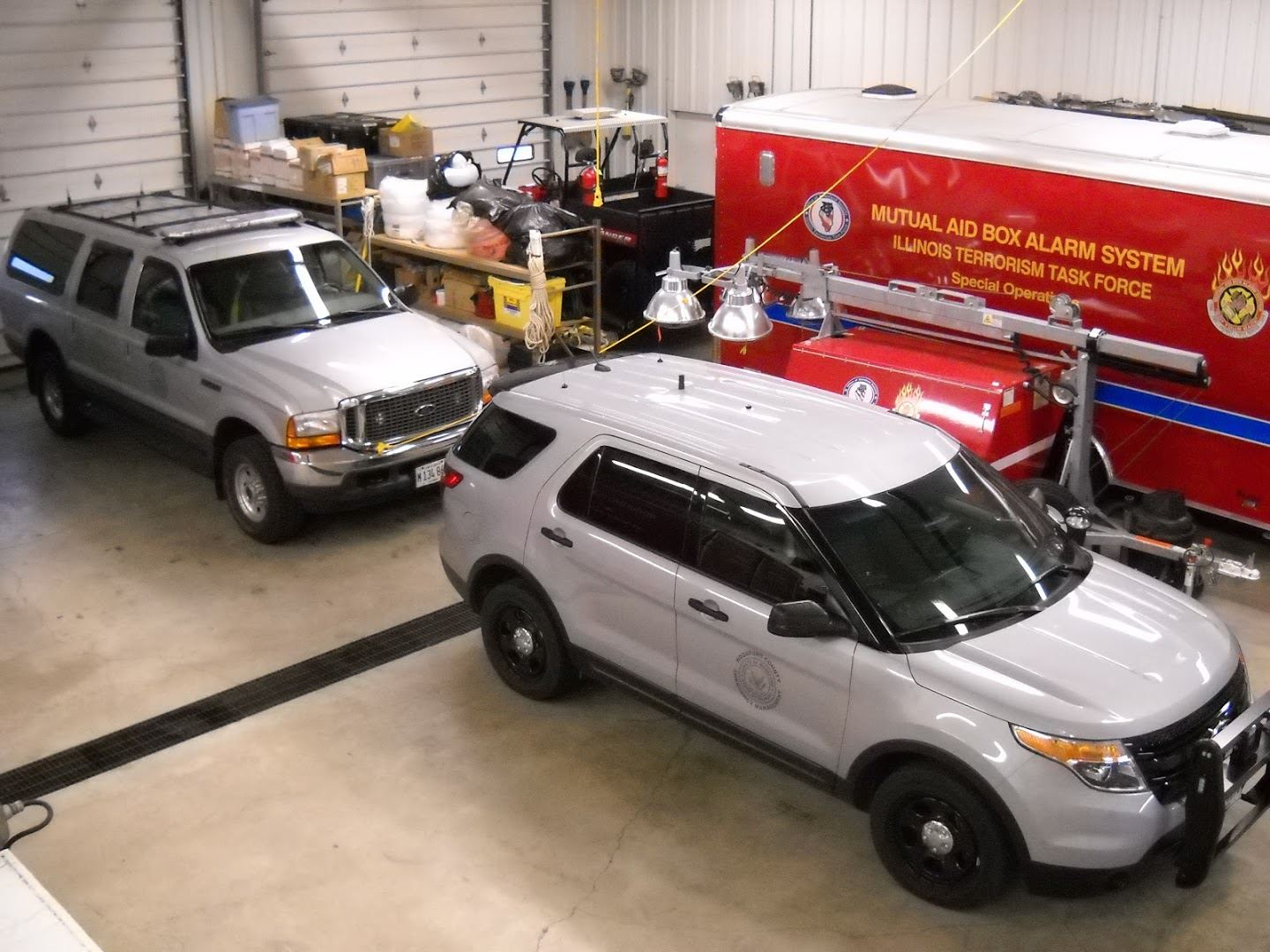 Mutual Aid Box Alarm System and SUV from Above in Garage Bay